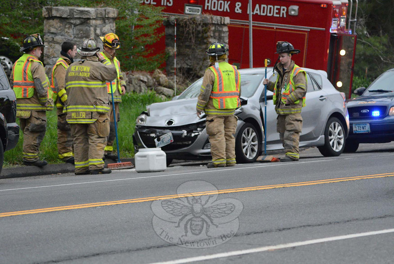 Police report a two-vehicle accident on southbound South Main Street, north of its intersection with Prospect Drive and Pecks Lane, about  5:08 pm on May 8 during the evening rush. In the incident, a 2010 Mazda 3 sedan, which was driven by Laura Digennaro, 35, of Monroe, struck the rear end of a 2005 Honda Pilot SUV driven by Kimberly Woodard, 47, of 10 Hanover Road, police said. Newtown Hook & Ladder volunteer firefighters responded to the call. The accident resulted in travel delays in the area. Police said they issued Digennaro a written warning for following too closely and for a vehicle registration violation. (Gorosko photo)