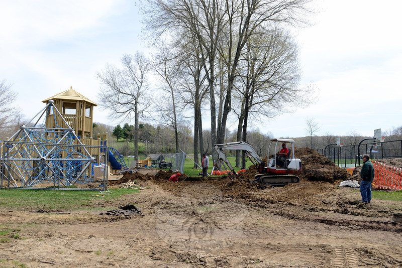 Dan Corsetti of Pat Corsetti Inc, at far right, oversees work as his crews installed new playground equipment at Dickinson Park last week. (Bobowick photo)