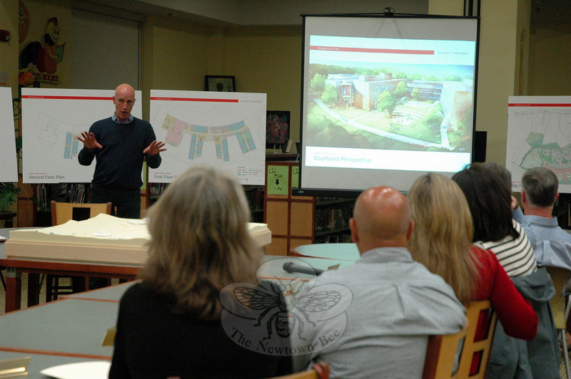 Svigals + Partners Company Principal Barry Svigals explained four renderings of what the new Sandy Hook School could look like during a May 14 Public Building & Site and Board of Education joint meeting. The main courtyard perspective, shown, includes a possible design for an amphitheater area. (Hallabeck photo)