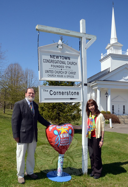 """Local Artist David Merrill stands beside a colorful heart he helped design for Families United in Newtown (FUN), which was founded by resident Linda Jones, right, in memory of her late son, Tyler. FUN will present a night of music, Friday, May 9, at 7 pm at Newtown Congregational Church, 14 West Street. Mr Merrill will be honored at the event during the unveiling of the """"traveling heart"""" that was handmade by special needs students and painted by the accomplished artist. The heart will go on display at the C.H. Booth Library following the concert, alerting patrons to the resources available at the library's """"Autism Nook."""" Admission to the concert is free, but FUN will be collecting donations at the door for continued support of the program and autism awareness. Light refreshments will be served. (Voket photo)"""