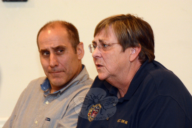 Town Director of Emergency Communications Maureen Will, right, speaks at an April 28 meeting of the Board of Fire Commissioners, as Jeffrey Capeci looks on. Ms Will, Mr Capeci, and Neil Chaudhary attended the session to discuss a proposal to move town emergency radio dispatching from Town Hall South to a Prospect dispatching center. (Gorosko photo)