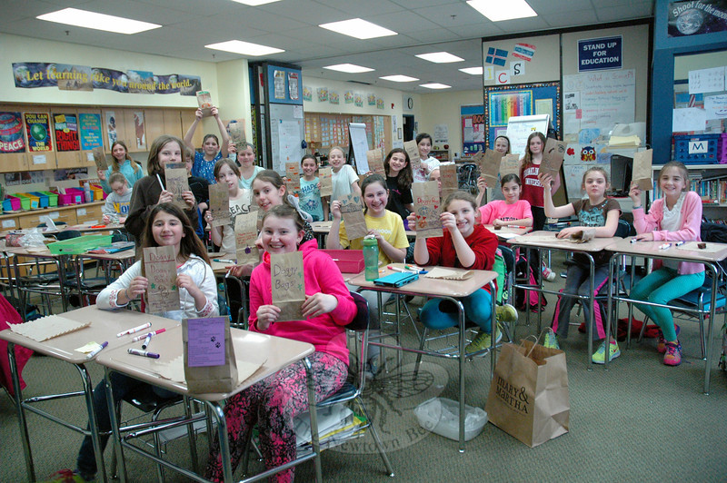 "Reed Kindness Club members held up ""doggie bags"" they were working on during the club's April 8 meeting. (Hallabeck photo)"