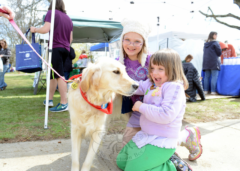 Scovill sisters Alexa, 4, and Jenna, 8, spent a few happy minutes with Roseanne Loring's therapy dog Abbey. (Bobowick photo)