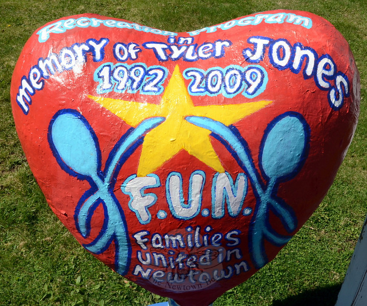 "Local Artist David Merrill helped design a colorful heart for Families United in Newtown (FUN), which was founded by resident Linda Jones, right, in memory of her late son, Tyler. FUN will present a night of music, Friday, May 9, at 7 pm at Newtown Congregational Church, 14 West Street. Mr Merrill will be honored at the event during the unveiling of the ""traveling heart"" that was handmade by special needs students and painted by the accomplished artist. The heart will go on display at the C.H. Booth Library following the concert, alerting patrons to the resources available at the library's ""Autism Nook."" Admission to the concert is free, but FUN will be collecting donations at the door for continued support of the program and autism awareness. Light refreshments will be served. (Voket photo)"