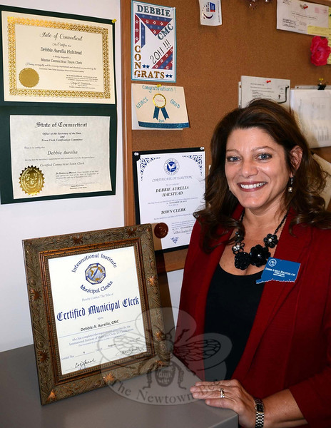 Town Clerk Debbie Halstead has surpassed several professional milestones since she took office nine years ago, including the latest: becoming one of Connecticut's 13 Master Certified Town Clerks. Office staffers Aileen Nosal and Renee Weimann are also working toward advanced certifications having re-cently become Certified Town Clerks. (Voket photo)