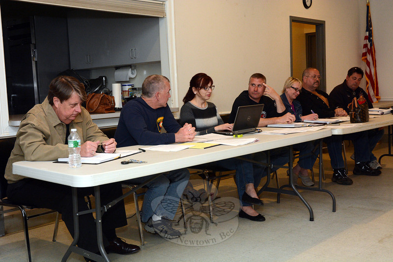 The Board of Fire Commissioners on April 28 discussed a proposal to move town emergency radio dispatching from Town Hall South to a Prospect dispatching center. Shown, from left, are commission civilian member Kevin Cragin; Michael Burton of Sandy Hook; commission secretary Terry Hennessey; Chairman Rob Manna of Hook & Ladder; civilian member  Elisa Goosman; Jay Nezvesky of Botsford; and David Jossick of Hawleyville. Member Ernie Descheneaux of Dodgingtown was absent. (Gorosko photo)