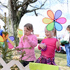Colorful pinwheel flowers catch the attention of Teagan Waaler, left, and Heidi Farnum. (Bobowick photo)