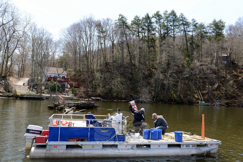 John Budrow, left, and Matt Vogt of New England Aquatic Services out of New Milford were on Lake Zoar Friday, April 25, installing safety buoys in hazardous areas. (Bobowick photo)