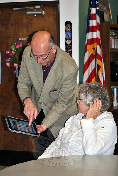 AT&T Director of External Affairs Harry Carey shows Esther Nichols how to find the apps store on an iPad or iPhone.	(Crevier photo)
