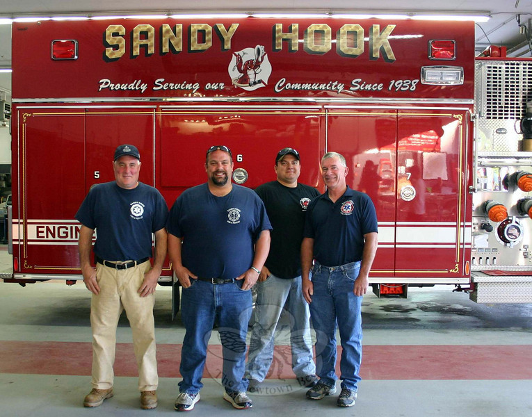 Members of Sandy Hook Volunteer Fire & Rescue Co., its Ladies Auxiliary, Junior Corps, and even family members and friends will all be volunteering their time to put on the 27th Annual Sandy Hook LobsterFest, a fundraiser for the company. The day event returns to Sandy Hook Fire & Rescue's main station, 18-20 Riverside Road, on June 6–7. Dinners will be served from 5 to 9 pm on Friday, and 4 to 9 pm on Saturday. A full steak or lobster dinner with plenty of sides and a drink are covered by tickets; surf and turf tickets are also available. Tickets are $24 in advance, until noon on June 6 (available at the firehouse; the fire marshal's office at Newtown Municipal Center, 3 Primrose Street; and The New-town Bee office, 5 Church Hill Road), and will be $26 at the door. Takeout orders can be set up. Children's dinners, with a burger or hot dog, are $5. A raw bar and desserts will also be available for separate charges. Midnight Rodeo will perform on Friday and The Hollister Thompson Band returns Saturday. The LobsterFest Committee this year is, from left, George Lockwood, Jr, Anthony Ca-pozziello, Matt Dobson, and Mike Burton. (Hicks photo)