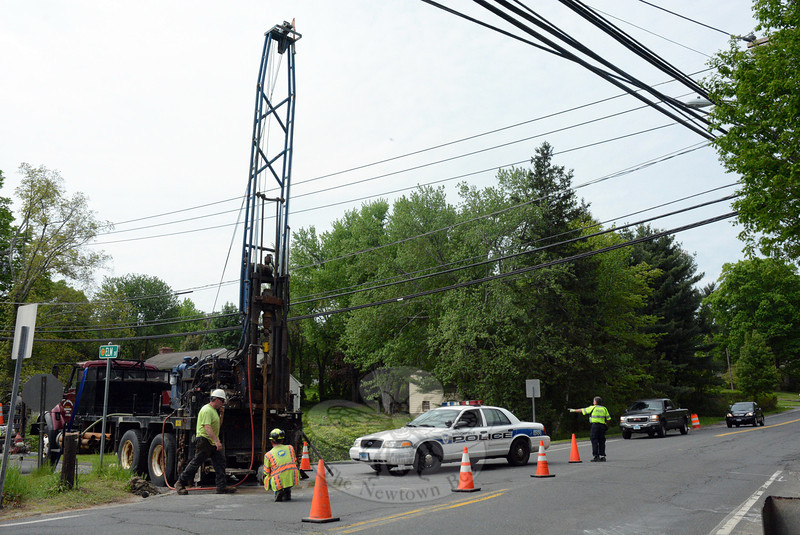 Workers for the state Department of Transportation (DOT) used a drilling rig on Wednesday morning to take subsurface core samples at the intersection of Sugar Street and Elm Drive. The DOT is doing the testing as part of a planned Sugar Street bridge replacement project there.  (Gorosko photo)