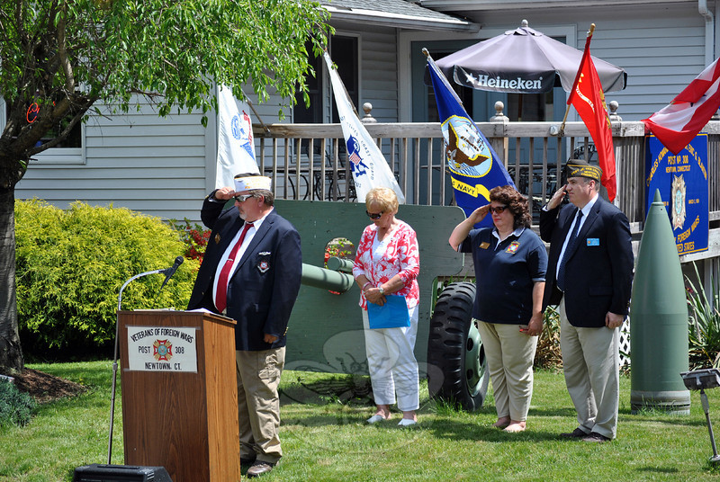 From left, VFW Commander James Rebman, Newtown First Selectman Pat Llodra, Donna Monteleone Randle, and Walter Dolan pay respects to service men and women who have died serving the United States. (Crevier photo)