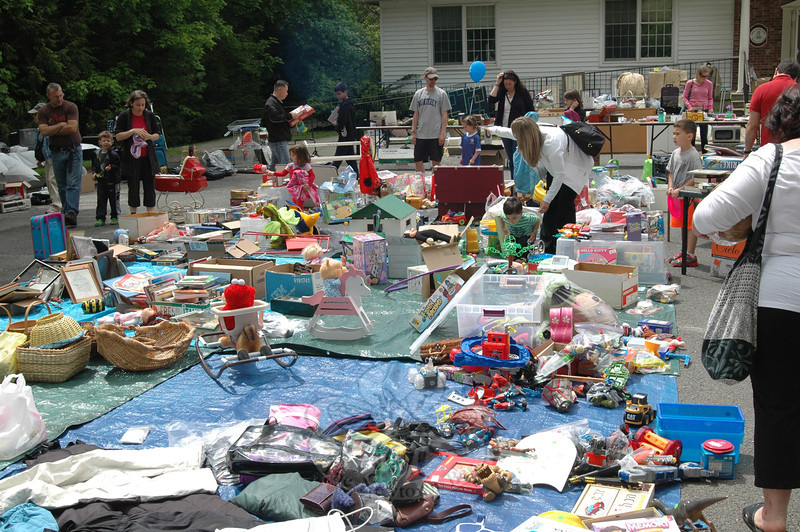 A tag sale held at Newtown Methodist Church during Saturday's Duck Race raised money to fill a pothole in front of Wesley Learning Center. (Gaston photo)
