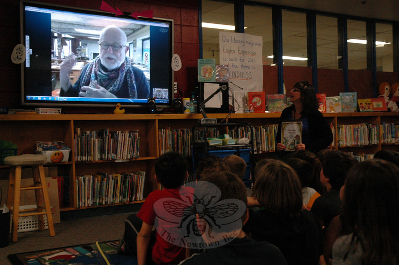 Sandy Hook School students and library/media specialist Yvonne Cech, sitting top right, interviewed author/illustrator Tomie dePaola using Skype on Friday, May 16. (Hallabeck photo)