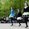 Younger members of the Gray's School of Irish Dance watch as some of their older cohorts, from left, Regina Hayes, Caroline Pickett, and Sarah Broggey, go airborne during a late morning demonstration on the Duck Race's Pootatuck stage. (Voket photo)