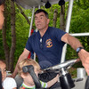 """Newtown Underwater Search And Rescue Chief Mike McCarthy explains some of the sophisticated navigational equipment on NUSAR's primary response vehicle that was part of two separate """"Touch a Truck"""" activities at the 2014 Duck Race. (Voket photo)"""
