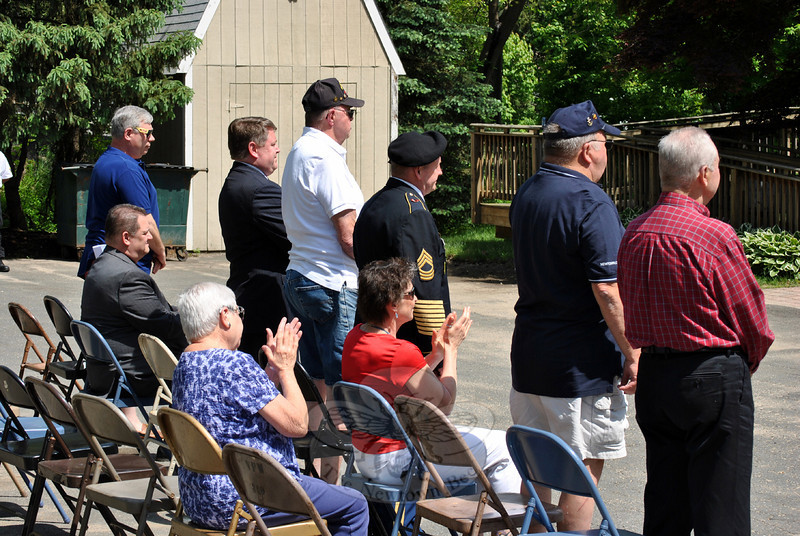Several veterans stand to be recognized by those attending the May 26 Memorial Day ceremony at VFW Post 308 on Tinkerfield Road. (Crevier photo)