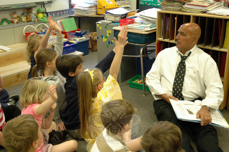 A number of guests visited Head O' Meadow Elementary School on Monday, May 12, to read to students. In different classrooms, Head O' Meadow students huddled around the visitors to hear them read from books, like in one classroom where Board of Education member John Vouros read When Dinosaurs Came with Everything by Elise Broach. (Hallabeck photo)
