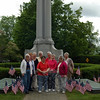 Members of Newtown Woman's Club stand in front of the Soldiers and Sailors Monument surrounded by American flags they had placed as a way to honor past and present veterans. Standing in front, from left, are Coke Cramer, Marion Thompson, Nancy Kennedy, and Betty Warner. Behind them, also from left, are Marie Sturdevant, Pat Denlinger, Jane Landgrebe, Marilyn Alexander, and Jean Smith. (Gaston photo)