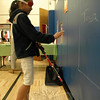 Middle Gate Elementary School fourth grade student Anna Johnson navigated her way toward a wall while wearing a blindfold and using a cane at one station during Middle Gate's Differences Day. (Hallabeck photo)