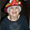 "Connie Sciglimpaglia is all smiles at the Mother's Day Tea, Tuesday, May 6, with a festive flower hat atop her head. Ms Sciglimpaglia later entertained guests as ""Carmen Miranda,"" complete with a fruit-covered hat. (Crevier photo)"
