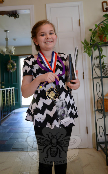 "Samantha Kuruc wears the many surprises she received from Ranny Green, including his Dog Writers Association of America Maxwell Award. Receiving it was like ""winning an Olympic gold medal,"" she said. (Bobowick photo)"