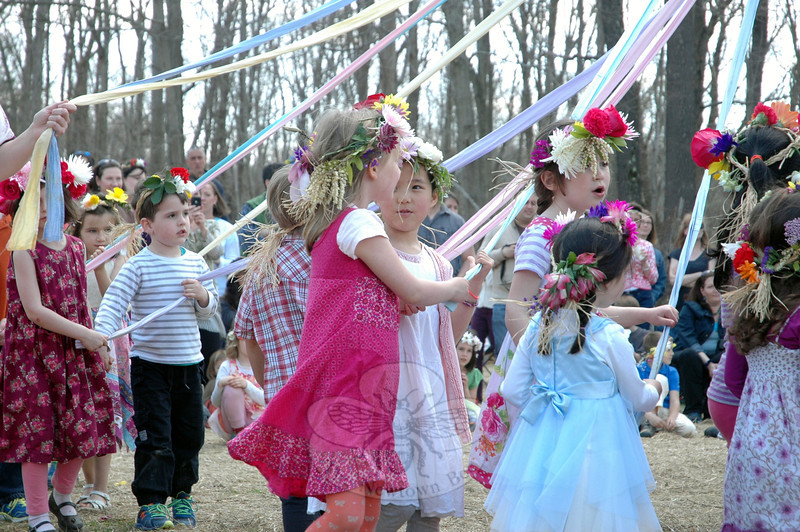 Early childhood students at Housatonic Valley Waldorf School wound ribbons around a Maypole on Friday, May 2, walking together in circles. (Hallabeck photo)