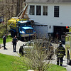 Police report a fuel delivery mishap about 11 am on May 7 that affected the house at 48 Marlin Road, within the Rollingwood residential subdivision. Police said that Rueben Cardona, Jr, 57, of Bridgeport, had just made a heating fuel delivery at the property with a 2005 Peterbilt fuel tanker owned by HOP Energy, LLC, of Bridgeport. While Cardona was outside the truck, for an unknown reason, the truck's brakes failed and the vehicle rolled backward down a steep driveway, crashing into the northeast corner of the house, damaging the house. No fuel spilled in the accident. There were no injuries. Botsford Fire Rescue volunteers responded to the scene, as did police, who took no enforcement. Chief Building Official John Poeltl said the house, which received structural damage, has been shored up and is habitable until repairs can be made. (Voket photo)