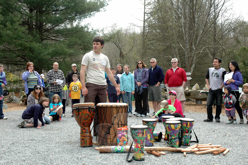 Two Coyotes Wilderness School Executive Director Justin Pegnataro addressed attendees at the Second Annual Two Coyotes Wilderness School Family Fun Day at Sticks and Stones Farm on Sunday, May 4, to welcome them to the event. (Hallabeck photo)