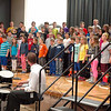 "Hawley Elementary School fourth grade students performed their spring concert for fellow students on Monday, May 5, under the guidance of music teacher Brian Kowalsky, bottom right. At one point, Mr Kowalsky accompanied the students by playing the drums. ""We've been working very hard to prepare some musical selections for you guys,"" Mr Kowalsky said at the start of the concert. Songs performed by the students included ""Surfin' the 'Net"" and Sara Bareilles's ""Brave."" The fourth graders were also scheduled to perform their spring concert for parents and family members on May 7. (Hallabeck photo)"