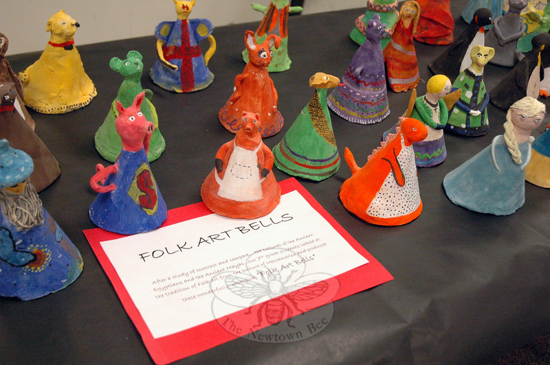 """Folk Art Bells,"" created by seventh grade NMS students after studying the cultures of ancient Egyptians and ancient Mayans, were on display in the school's lobby. (Hallabeck photo)"