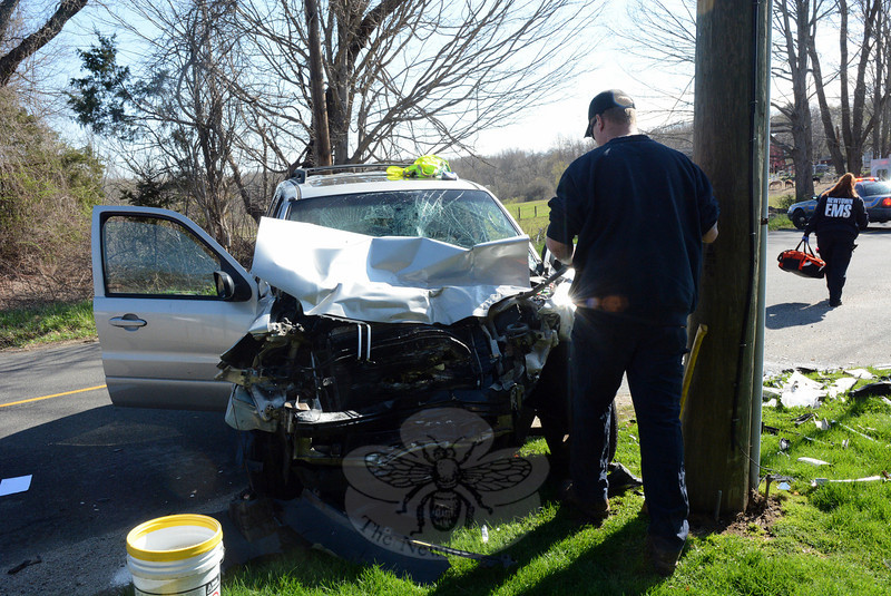 Police report that a two-vehicle head-on collision occurred about 8:45 am on Friday, May 2, on Meadow Brook Road, near its intersection with Lazy Brook Road. Besides police, the Newtown Volun-teer Ambulance Corps and Botsford Fire Rescue volunteers responded to the incident, which closed Meadow Brook Road to through-traffic while the police investigation was under way. Police said that motorist Amanda Sharpe, 24, of 206 Hattertown Road was driving a 2007 Mercury Mariner SUV eastward on Meadow Brook Road, as motorist Gennaro DiNapoli, 38, of 10 White Oak Farm Road was driving a 2013 Dodge Ram pickup truck westward there. The two vehicles then collided. Police said that both drivers and Mercury passenger Thomas J. Sharpe, 26, of 206 Hattertown Road all were transported by ambulance to the hospital for treatment of injuries. Amanda Sharpe received an infraction for failure to drive to the right, police said. (Gorosko photo)