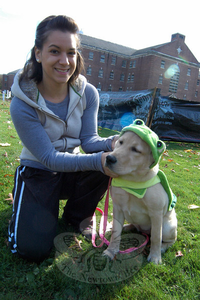 "Therea Viesto helped Fantasia, who is for sale at Mount Pleasant Hospital for Animals, with her costume at the ""Howl-o-ween"" event held to benefit Newtown Park and Bark. (Hallabeck photo)"