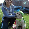 """Therea Viesto helped Fantasia, who is for sale at Mount Pleasant Hospital for Animals, with her costume at the """"Howl-o-ween"""" event held to benefit Newtown Park and Bark. (Hallabeck photo)"""