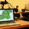 Inland Wetlands Commission (IWC) members discussed the 42-lot Sherman Woods residential subdivision at an October 23 meeting. A color topographic map of the development proposal was displayed on the monitor of a laptop computer, foreground, and also projected onto a large screen in the main meeting room at Newtown Municipal Center during that IWC session. Development applications submitted to town land use agencies may be filed in electronic form as well as on paper.  (Gorosko photo)