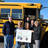 "From left, front, All-Star Transportation bus drivers Bill Belward, Joan Buamgart, Joanna Gamble, and Newtown Social Services director Ann Piccini; and drivers Linda Nasse and Ernie Fakone, rear, as well as All-Star Transportation employees encourage the public to support the All-Star Transportation ""Stuff A Bus"" food donation campaign, Saturday, November 9, at Stop & Shop at Sand Hill Plaza, Route 25, from 8 am to 5 pm. Donations of all food items are welcome, and will go to fill the shelves at the town food pantry at Social Services, South Main Street. Due to the storms of the past two years and continued economic stresses, the town food pantry has been severely depleted, said Ms Piccini. (Crevier photo)"