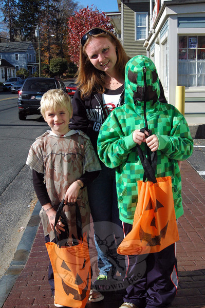 Brett, left, mom Jeannine, and Blacke Palmer made their way through Sandy Hook at Saturday's Halloween Walk. (Hallabeck photo)