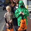 Brett, left, mom Jeannine, and Blacke Palmer made their way through Sandy Hook at Saturday's Halloween Walk. (Hallabeck photo)