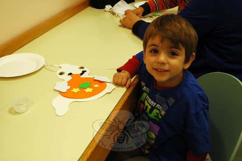 Daniel Siebern decorated a paper ghost at a Drop-In Halloween Craft event held at C.H. Booth Library on Thursday, October 24. (Silber photo)