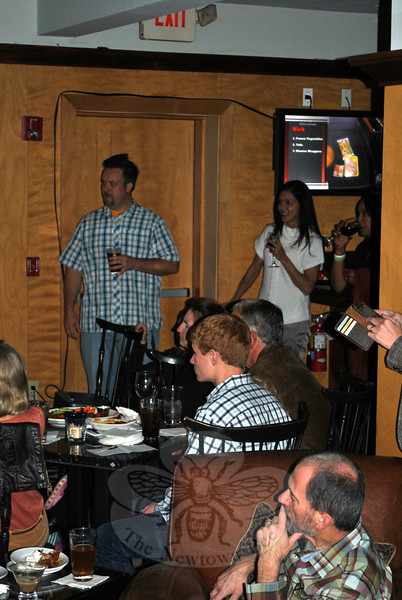 Friends and family are glued to the television sets at Proud Mary's at the Inn at Newtown, Sunday evening, to see if Chef Plum comes away the winner of Guy's Grocery Games, a Food Network cooking challenge. (Crevier photo)
