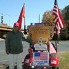 "Mr Rinaldi drives around in a golf cart bedecked with American and Marine Corps flags, stickers of American flags, and signs encouraging support for all troops. ""I support all the Armed Forces members,"" he said. ""We kid among ourselves, but we're all on the same football field."" On the back of Mr Rinaldi's seat is a sign honoring his late father, Domenic A. Rinaldi. ""His spirit is always with me,"" said Mr Rinaldi. (Hicks photo)"