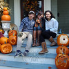 Great Pumpkin Challenge creator Mackenzie Page, center, and friends, Justin Faith, left, and Caroline Cole, sit on the steps of 14 Main Street, where pumpkins donated to this year's Great Pumpkin Challenge will be on display for Halloween, October 31. (Hallabeck photo)