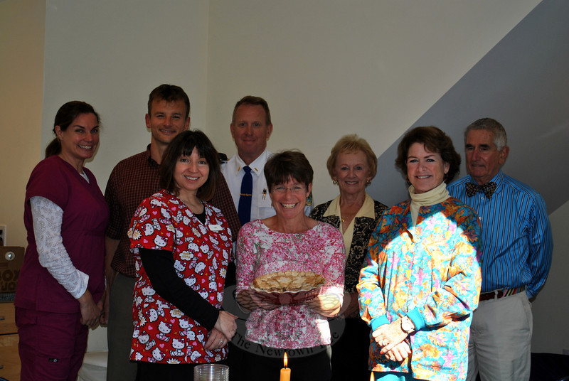 Taking part in the Newtown Center Pediatrics intraoffice apple pie contest Monday, October 28, from left, rear row, receptionist Cindy Shaw, judges Dr David Nowacki and Lt Sinko, Mrs Llodra, and Mr Smith; front, medical assistant Lois Barber, contest winner Dr Laura Nowacki and her pie, and receptionist Patti Moore. (Crevier photo)