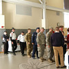 Nine military veterans lined upon entering the St Rose of Lima School's Gathering Hall for the school's Veterans Day Assembly. (Silber photo)