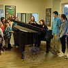 "Anna DeMasi, a piano and voice teacher, and a group of her students sing ""Tomorrow"" during an open house for Sabrina's Encore Productions LLC. (Bobowick photo)"