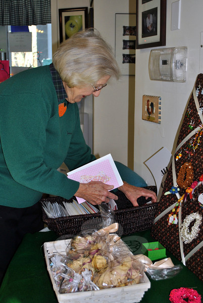 "Mary Peck looks over the selection of handmade gift cards at the Newtown Senior Center Annual Harvest Bazaar, Friday, November 8. ""These are really beautiful. They've done a good job,"" said Ms Peck. The Friday and Saturday Bazaar raised funds to support Senior Center programs throughout the year. (Crevier photo)"