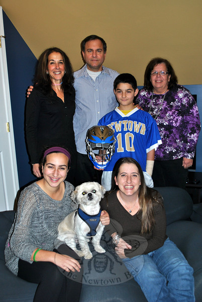 "The Bogdanoff family is all smiles after having son Justin's ""Dream Come True,"" thanks to the local Dream Come True team that recently redecorated the 12-year-old's room to reflect his love of the NHS Nighthawks. From left, rear, are Liz Bogdanoff, Tod Bogdanoff, Justin Bogdanoff, and Dream Come True team member Roseanne Augustine; front, Julia Bogdanoff, Louie the dog, and Kristie Perry, Dream Come True manager. (Crevier photo)"