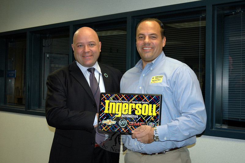 Todd Ingersoll, right, president of Ingersoll Automotive of Danbury, met with Newtown High School Principal Charles Dumais on Monday, November 18, to donate ten laptops to the high school from his dealership. (Hallabeck photo)