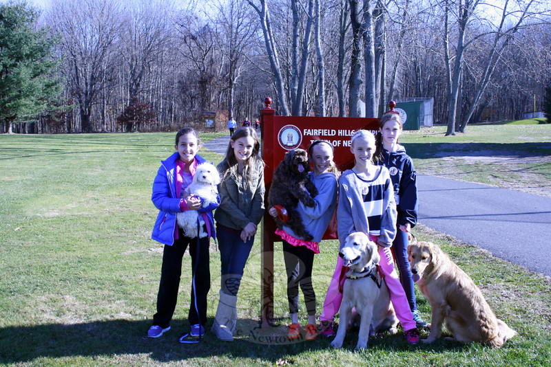 "The ""Wolf Pack"" soccer team came together Saturday, November 16, to support the Kids Lend A Paw (KLAP) dog walk at Fairfield Hills. The team includes, from left,  Olivia Cavallaro with Rudy, KLAP founder Maddie Stites, Faith O'Hara with Angel, Hannah Garoonell with Shadow, and Colleen Phaneun with Maisy.  (Silber photo)"