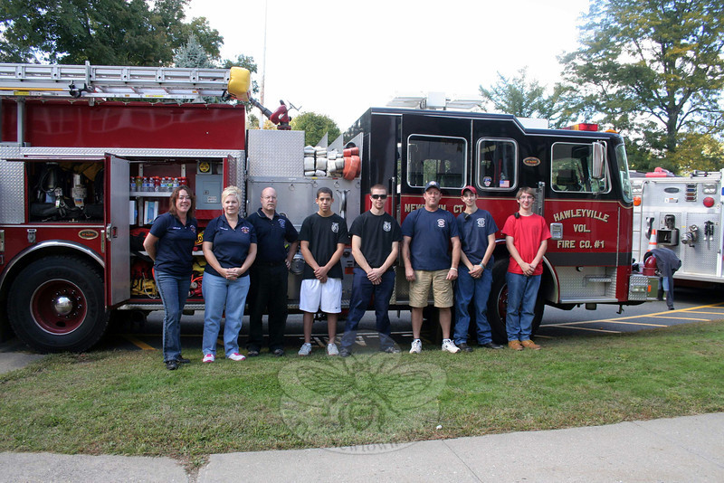 Members of all five of Newtown's fire companies will be outside two of the town's food markets this weekend, collecting donations for FAITH Food Pantry. The 13th Annual Fill The Fire Truck Food Drive will take place Saturday, November 23, from 9 am to 2 pm. Members of Hawleyville, Hook & Ladder, and Sandy Hook companies will be outside Big Y, at 6 Queen Street; while Botsford and Dodgingtown will be stationed outside Stop & Shop in Sand Hill Plaza, 228 South Main Street. Food, personal hygiene and cleaning items will all be accepted on Saturday, as will financial donations. Everything will be delivered to FAITH Food Pantry, a non-ecumenical pantry located in the undercroft of St John's Church in Sandy Hook Center, that afternoon. From left are members of Sandy Hook Fire & Rescue Ladies Auxiliary, Dodgingtown, Botsford, and Sandy Hook Fire & Rescue, who were already thinking about the food drive during the recent Great Newtown Health Fair. (Hicks photo)